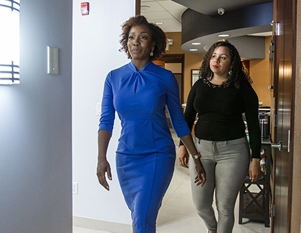 Wellington Periodontist walking in blue dress with patient