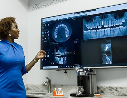 Wellington Periodontist looking at x-rays